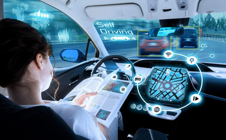 Woman reading in a self driving car