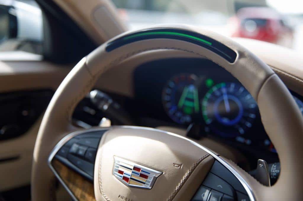 The steering wheel light bar, along with other audible and visual alerts, will prompt an inattentive driver to regain focus. In certain situations, Super Cruise can stop the vehicle and alert the authorities via OnStar. Photo: Cadillac.