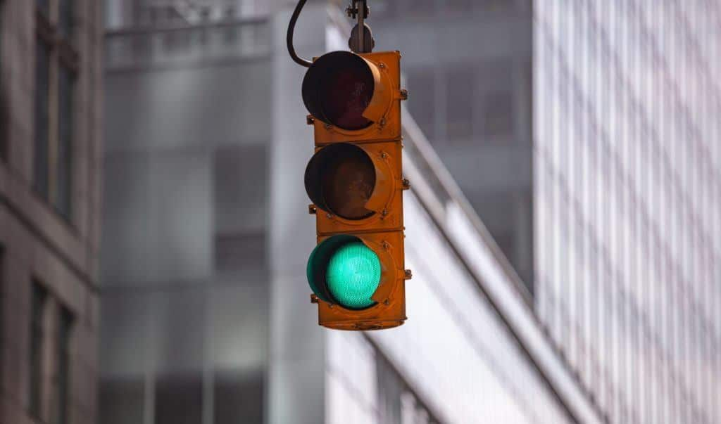 Traffic light turning green. Some proponents in the ADAS community believe connected infrastructure will play a role in creating safe roads.