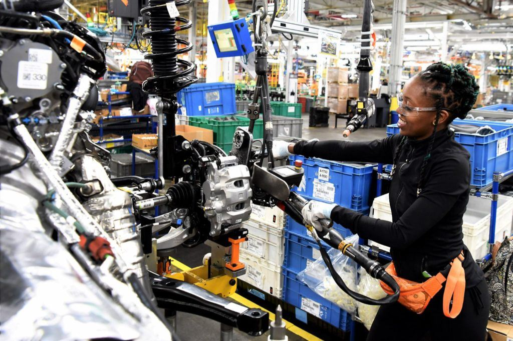 Ford employee Ebony Atkins-Conner installs mechanical components on the 2020 Ford Explorer at the Chicago Assembly Plant.