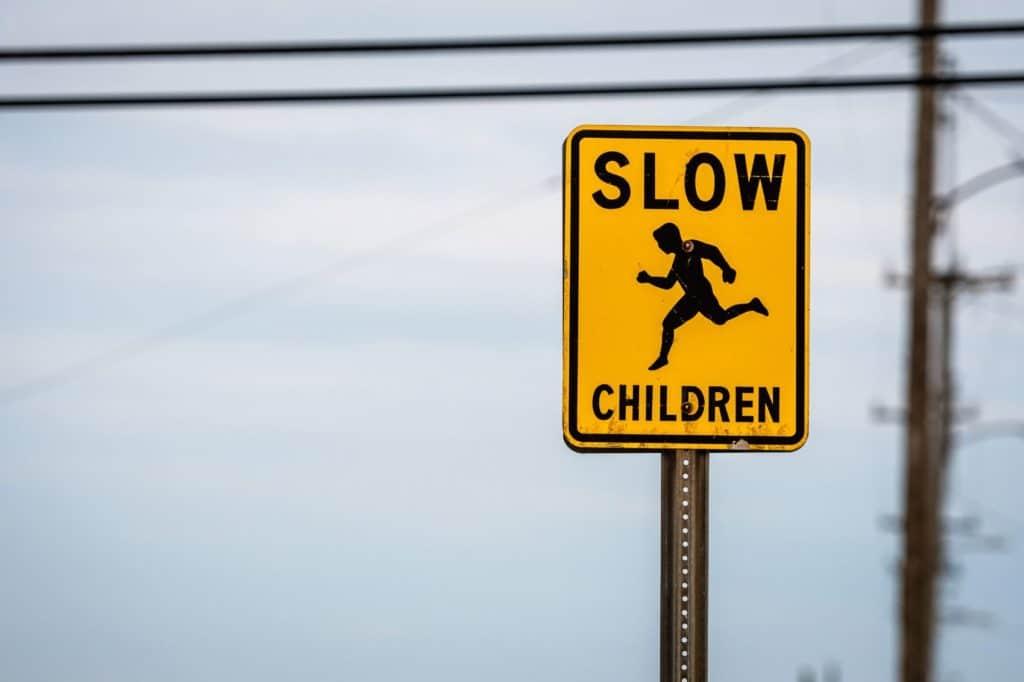 Slow children road/warning sign.